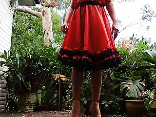 sissy ray outdoors in red dress 2