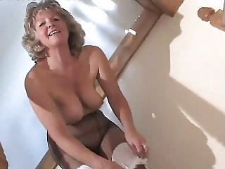 ORABLE GRANNY IN BLACK PANTYHOSE TOYING ON THE STEPS