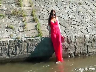 Brunette gets wet in the river
