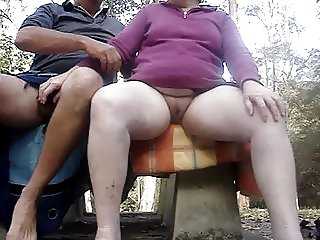 STURBATING TOGETHER OUTDOORS ON A WET DAY