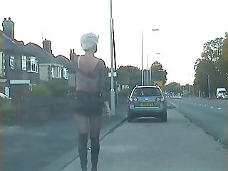 Shemale Whore in public skirt too short to hide her cock