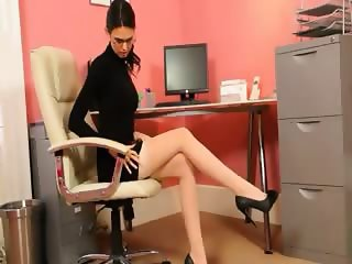 Secretary in sexy black heels stripping