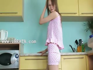 Pussy undressing and dildoing in kitchen