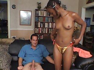 Black girl sucks on a big white cock on the sofa