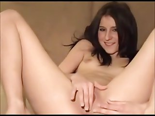 Cute white chick rubs her wet pink