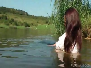 Sexy slut getting wet in the lake