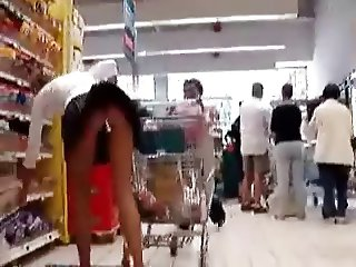 Walking around store with dildo in her ass