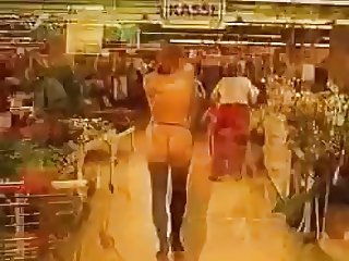 Young Redhead walks through shopping mall.