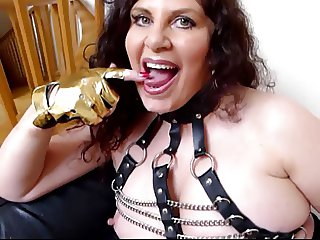 British slut Gilly gives a blowjob to a man in a pig mask