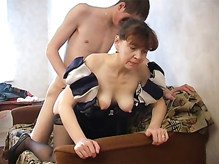 SSIAN GRANNY ELIZABETH IN STOCKINGS IS GETTING NAILED BY HER YOUNG LOVER